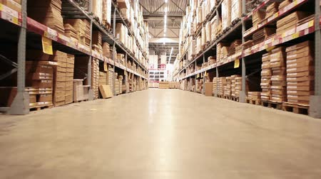 industry : Camera moving between palettes with ordered goods and materials at warehouse