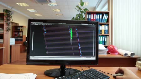 architektonický : 3D model of construction building at computer monitor screen with working engineer