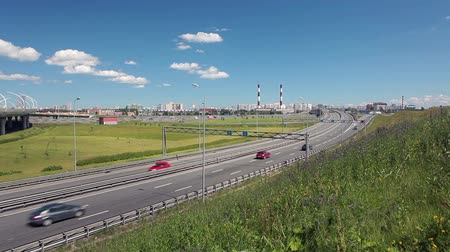 yolları : Panorama of turning to the highway ring road and crossing Western High Speed Diameter elevated route in Saint-Petersburg, Russia Stok Video