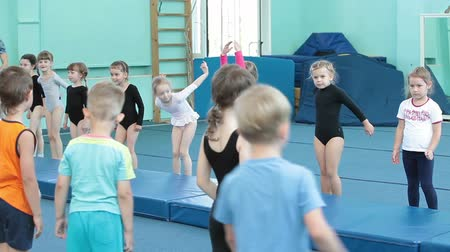 gimnastyka : Young kids practice acrobatic exercises. Children sport school of Olympic reserve in Saint-Petersburg