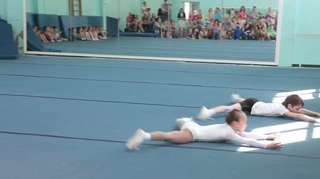 gimnastyka : Young sportsmen showing acrobatic dance. Children sport school of Olympic reserve in Saint-Petersburg