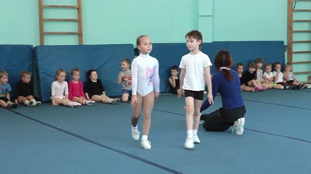 sport dzieci : Young sportsmen showing half lever position. Children sport school of Olympic reserve in Saint-Petersburg