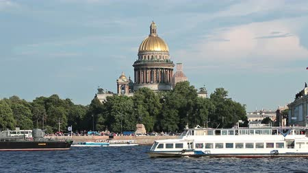 sobor : Camera zoom out from Saint Isaac Cathedral to Neva river with pleasure ships. Saint-Petersburg, Russia