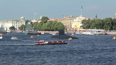 saintpetersburg : Camera zoom in small ship turning across river and submarine near bank. Saint-Petersburg, Russia