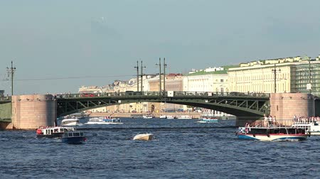north bay : Bay of Neva river with small and big passenger pleasure boats passing Palace bridge, Saint-Petersburg, Russia Stock Footage