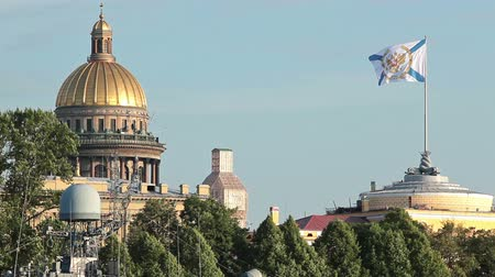 saintpetersburg : St Isaac Cathedral roof and waving Russian Navy flag on courthouse, St Petersburg, Russia Stock Footage