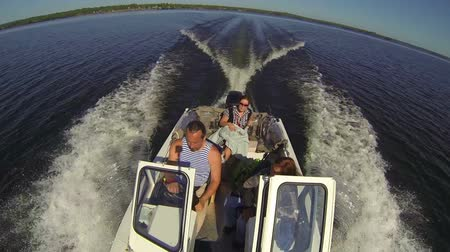 lancha : Fisheye view of speedboat riding a large lake at sunny day, people on a board