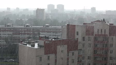 ulewa : Heavy rain over city sleeping district, view over roofs, Russia