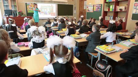 initial : Teacher showes pupils how to answer at lesson due hands up. September, 1 in Russia