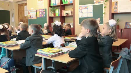 initial : Classroom in primary school with first-form schoolers are sitting at lesson. September, 1 in Russia Stock Footage