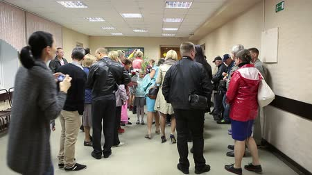 aluno : Parents photographing schoolchildren when they standing in school hall in line. September, 1 in Russia Stock Footage