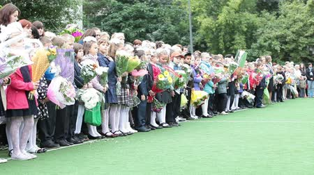 идущий : Russian first-graders boys and girls are at the line before school. September 1. Russia