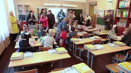 initial : Parents escorting children in school at first time, first-form class, September, 1 in Russia