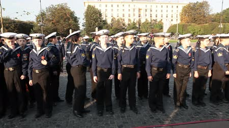 saintpetersburg : ST. PETERSBURG, RUSSIA - SEPT, 21, 2014: Naval College cadets stand in line when vessel Aurora leaves her mooring place for repair works. Cruiser Aurora is a symbol of Revolution of 1917 year Stock Footage
