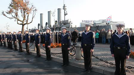 saintpetersburg : ST. PETERSBURG, RUSSIA - SEPT, 21, 2014: Cruiser Aurora mooring place with sailors stand in line when ship is ready to tugging for repair works. Cruiser Aurora is a symbol of Revolution of 1917 year