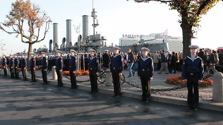 saintpetersburg : ST. PETERSBURG, RUSSIA - SEPT, 21, 2014: People are on Cruiser Aurora mooring place when ship is ready to tugging for repair works. The Cruiser Aurora is a symbol of Revolution of 1917 year