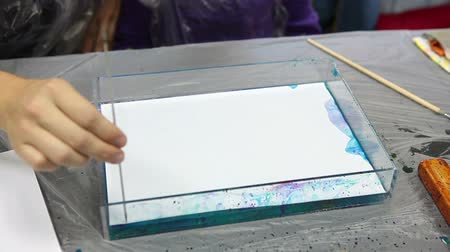 sulu : Picture printing to white sheet of paper after drawing on water. Ebru art Stok Video