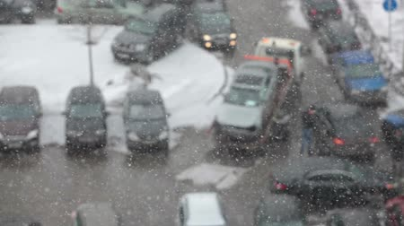 evacuated : Defocusing view of tow truck takeing broken car from the parking lot. Heavy snow. Saint-Patersburg, Russia