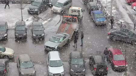 evacuated : View of tow truck loading broken car from the parking lot. Heavy snow. Saint-Patersburg, Russia Stock Footage