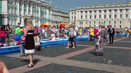 alexander column : SAINT-PETERSBURG, RUSSIA - JUNE 1, 2013: International Childrens Day celebration on Palace Square on June 1, 2013 in Saint-Petersburg, Russia. Inflatable pools for kids on square