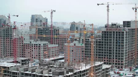инвестирование : City buildings under construction covered with snow in winter season. Russia Стоковые видеозаписи