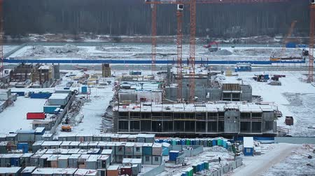 épít : Working town on the construction site with barracks for living, Russia Stock mozgókép