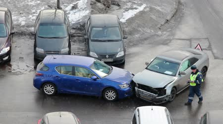 kaza : Russian officer with drivers making inspection of car accident place. Two front crashed cars in Russia