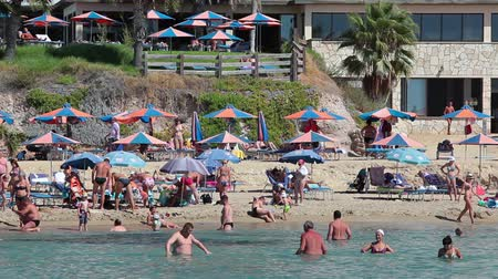 ciprus : Coral Bay sandy beach with resting people on the sand and in water, Paphos, Cyprus