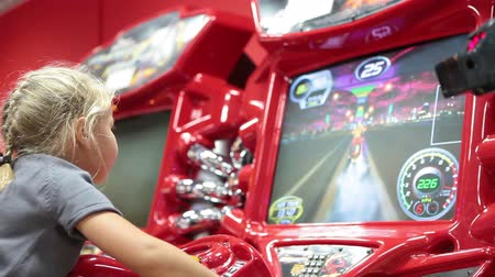 vending machine : Simulator racing machine controlled small girl with video screen riding motorcycle Stock Footage