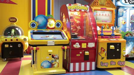 vending machine : Colorful coin-operated machines are in gaming zone