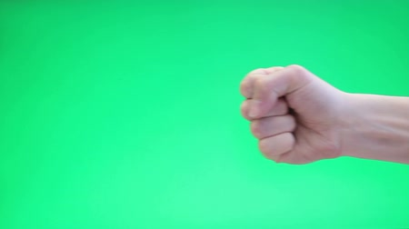 кулак : Hand with fist over green chromakey background