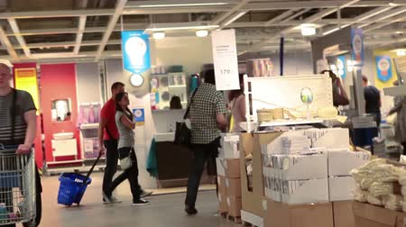 raf : Camera moving through the crowd of customers in Ikea showroom