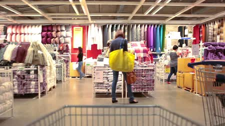 áruk : Timelapse of camera moving through the crowd of customers in Russian Ikea showroom