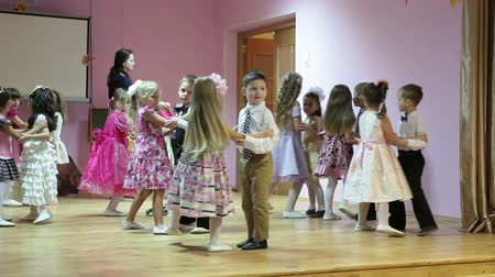 kiddy : performance on the kindergarten`s stage with children dancing in a couples. Russia. 4-5 years old