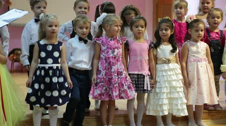 kiddy : Young girls and boys reciting poetry from the stage in kindergarten, Russian preschool children Stock Footage