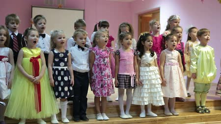 kreş : Preschooler children singing song and waving hands over heads, Russian kindergarten