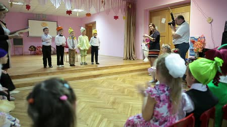 kiddy : Parents day in kindergarten with performance on the theatre stage. Children reciting poetry. Russia Stock Footage