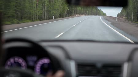 droga : Car driving on a country road. Focus on the road. View from vehicle