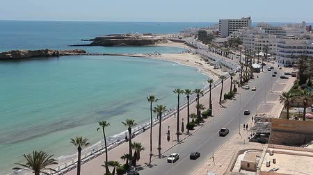 kasaba : The road along the waterfront in the town of Monastir, the Mediterranean Sea, Tunisia Stok Video