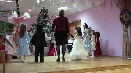 ded : SAINT-PETERSBURG, RUSSIA - CIRCA DEC, 2013: Russian Santa Claus (Father Frost, Ded Moroz) turning the light on Cristmas Tree with children standing around. Russian nursery school, Russia