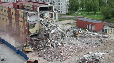 yıkım : Building demolition and crashing by machinery for new construction, St. Petersburg, Russia Stok Video