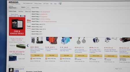 e ticaret : MOSCOW, RUSSIA - CIRCA DEC, 2014: Black friday shopping page is in Amazone.com store. Amazone.com is the largest Internet-based company in electronic commerce Stok Video