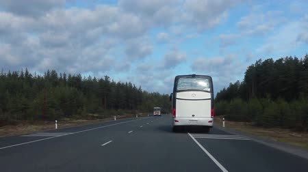 asphalt road : Driving next to bus and overtaking it on afphalt road, Scandinavia route in Russia
