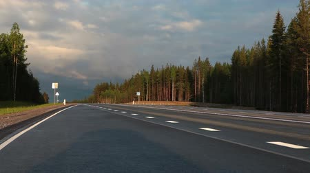 rota : View at the lonely car driving on empty road at early morning, Karelia, Russia Vídeos