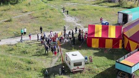 цирк : People coming out of the traveling circus big top in Segezha town, Karelia, Russia Стоковые видеозаписи