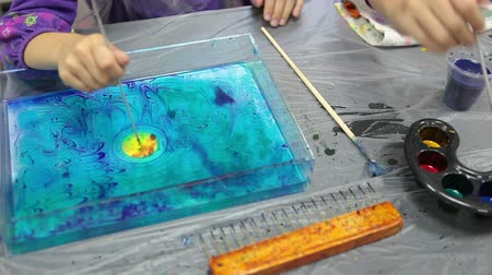 aqueous : Ebru drawing place with child making picture on water