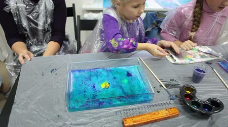 aqueous : Kids are on Ebru drawing lesson making pictures on water