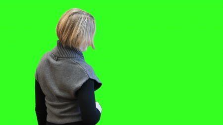 érintőképernyő : Caucasian woman in 3D glasses pushing buttons on screen, rear view, greenscreen