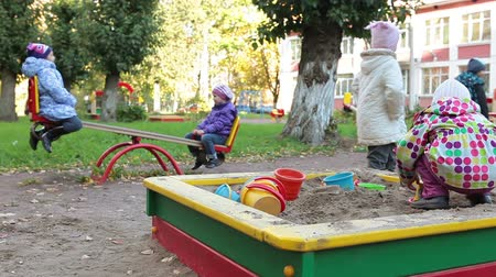 preschool : Children`s playground with sandbox and seesaw. Russian kindergarten Stock Footage