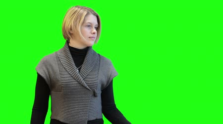 érintőképernyő : Young Caucasian woman scrolling screen with hand, front view, pre-keyed greenscreen